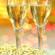 Two glasses of champagne against bokeh background — Stockfoto #37555953