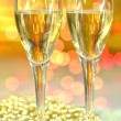 Two glasses of champagne against bokeh background — Stock Photo #37555953