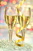 Two glasses of champagne against bokeh background — Stock Photo