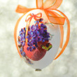 Easter egg decorated with flowers made by decoupage technique on bokeh background — Zdjęcie stockowe #41443579