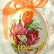 Easter egg decorated with flowers made by decoupage technique on bokeh background — Zdjęcie stockowe #41443617