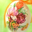 Easter egg decorated with flowers made by decoupage technique on green background — Zdjęcie stockowe #41443735
