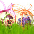 Easter eggs decorated with flowers made by decoupage technique in the grass — Stock Photo #42276635