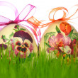 Easter eggs decorated with flowers made by decoupage technique in the grass — Stock Photo #42276649