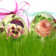 Easter eggs decorated with flowers made by decoupage technique in the grass — Stock Photo #42276661