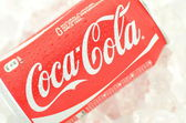 Can of Coca-Cola drink on ice — Stock Photo