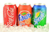 Can of Coca-Cola, Fanta and Sprite drinks on ice — Stock Photo