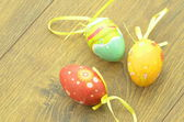 Colorful Easter eggs lying on a table — Stock Photo