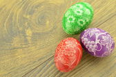 Colorful scratched handmade Easter eggs on a table — Stock Photo