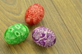 Colorful scratched handmade Easter eggs on a table — Стоковое фото