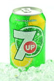 Can of 7 Up drink on ice isolated on white — Stock Photo