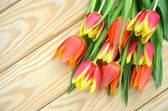 A bouquet of tulips on a wooden table — Stock Photo