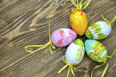 Colorful Easter eggs lying on a table — Foto de Stock