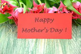 Happy mothers day and bouquet of gorgeous red tulips — Stock Photo