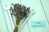 Happy fathers day wishes, bunch of gorgeous dry lavender flowers and spanners — Stock Photo