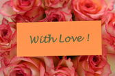With love wishes and bouquet of gorgeous roses — Stock Photo