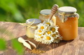 Jars full of delicious honey and bee pollen in apiary — Стоковое фото