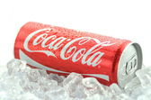 Bottle of Coca-Cola drink on ice cubes — Stock Photo