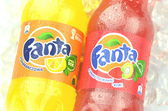 Bottle of Fanta drink on ice cubes — Stock Photo