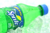 Bottle of Sprite drink on ice cubes — Stock Photo