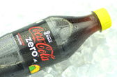 Bottle of Coca-Cola Zero drink on ice cubes — Stock Photo