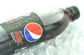Bottle of Pepsi Max drink on ice cubes — Stock Photo