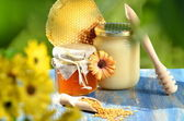 Jar full of delicious honey, honeycomb and bee pollen in apiary — ストック写真