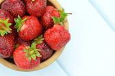 Fresh and delicious strawberries in a bowl on a  table — Stock Photo