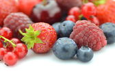 Variety of soft fruits, strawberries, raspberries, cherries, blueberries, currants isolated on white — Stock Photo