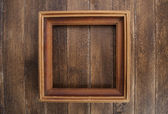 Vintage picture frame, on wooden background — Stock Photo