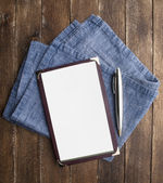 Notebook paper with pen on wooden table — Stockfoto