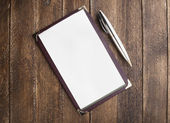 Notebook paper with pen on wooden table — Stok fotoğraf