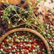 Peppercorn mix in wooden bowl, herbs and spices — Stock Photo #51396945