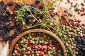 Peppercorn mix in wooden bowl, herbs and spices — Stock Photo