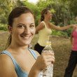 Female holding a bottle of water. - Stock Photo