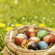 Royalty-Free Stock Photo: Basket filled with colourful hand-painted Easter eggs.