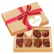 Chocolate candies and gift box with bow. vector illustration — Imagens vectoriais em stock