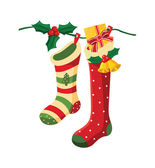 Vector illustration of christmas socks hanging on a wire. — Stock Vector