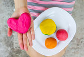Creating Heart toys from play dough — Stock Photo