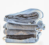 Stack of jeans isolate — Stock fotografie
