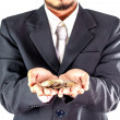 Businessman have stack of coins on hand — Stock Photo #32906801