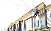 Electrician working on electric power pole — Stock Photo