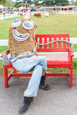 Red chair with scarecrow — Stock Photo