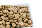 Dog food in a bowl on white background — Stock Photo