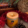 Christmas still life with candle — Stock Photo #23115054