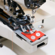 Machine for sewing on buttons of electric type — Stock Photo
