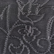 Black synthetic leather with embossed texture — Stockfoto