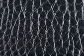 Black synthetic leather with embossed texture — Stock Photo