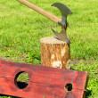 Stock Photo: Executioner's ax and wooden shackles