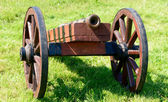 Ancient cannon on wheels — Stock Photo